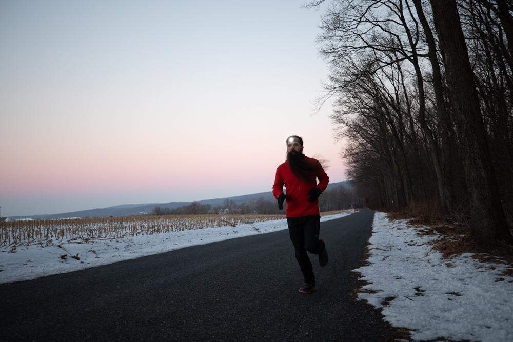 Steven running on winter road with headlamp