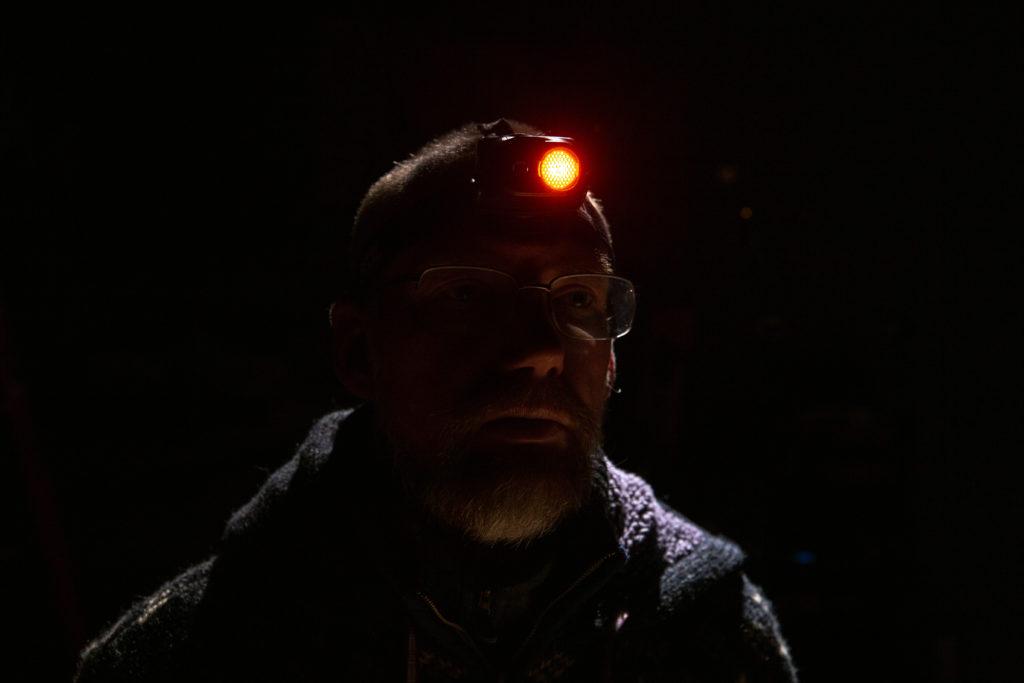 Troy wearing headlamp, using red light setting