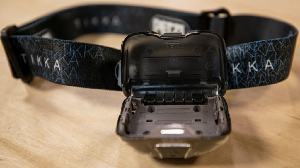 Open battery compartment on Petzl headlamp