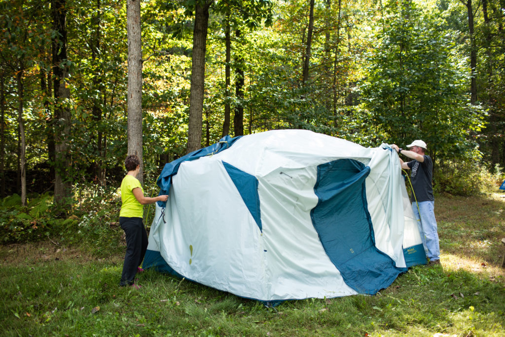 Troy and Cassie setting up family camping tent