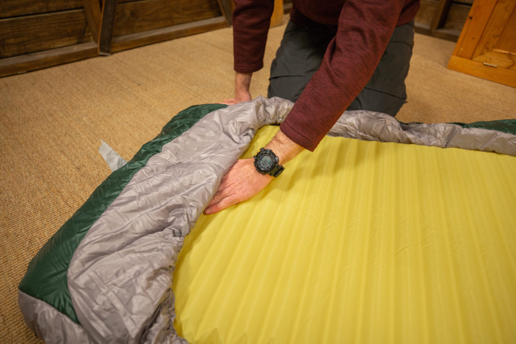 Sleeping pad under backpacking quilt