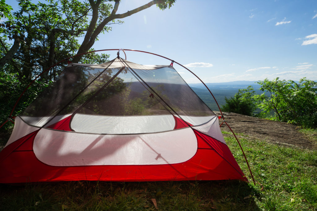 MSR backpacking tent overlooking green hills