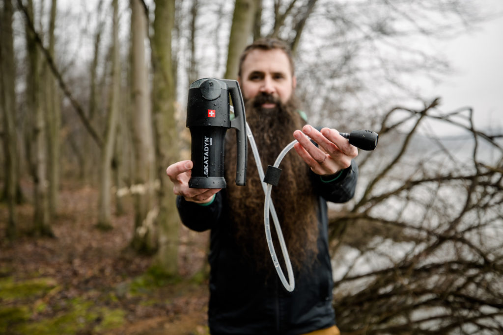 Steven holding Katadyn pump filter along Pennsylvania river