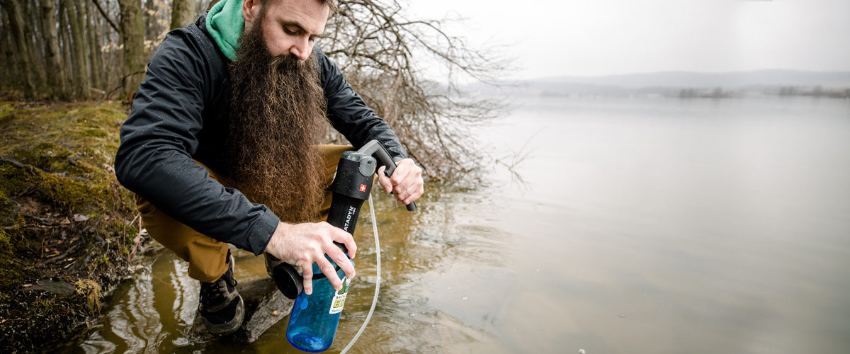 Steven using Katadyn backcountry water filter on Pennsylvania river