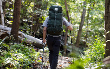 Person backpacking with pack
