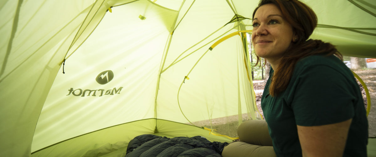 woman inside green tent