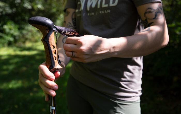 Hiker adjusting Trekking Poles