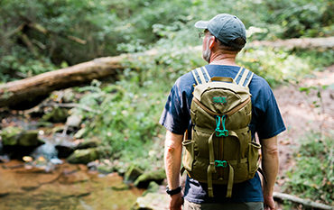 Man with backpack in the woods