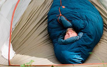 camper sleeping in tent