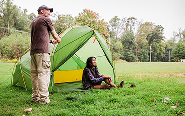 man and woman with green tent