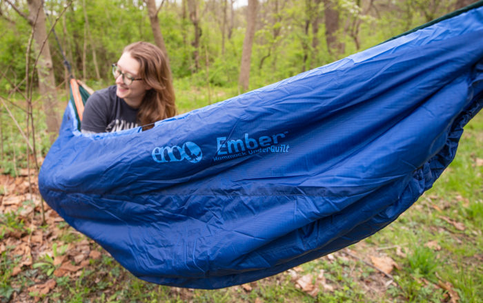 Woman camping with ENO Ember Underquilt