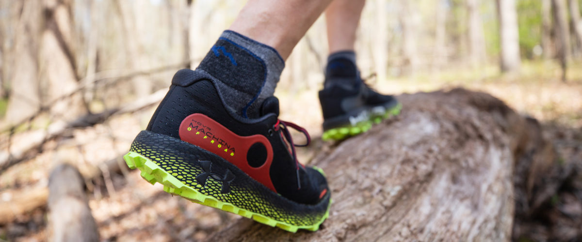 Trail running wearing Under Armour Hovr Machina shoes